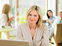 Woman Using Laptop In Cafe Stock Images