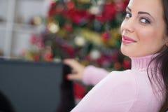 Woman using laptop on Christmas night Stock Photo