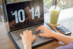 Woman using laptop in the coffee shop Stock Images
