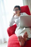 Woman using a laptop computer at home Stock Photos