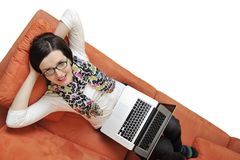 Woman using a laptop computer at home Royalty Free Stock Image