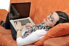 Woman using a laptop computer at home Stock Images