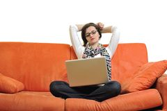 Woman using a laptop computer at home Stock Photo