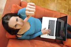Woman using a laptop computer at home Stock Photography