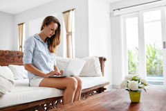 Woman Using Laptop Computer Home, Relaxing. Communication Technology Stock Photography