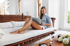 Woman Using Laptop Computer Home, Relaxing. Communication Technology Stock Image