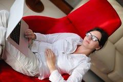 Woman using a laptop computer at home Stock Photos
