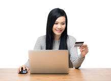 Woman using laptop computer for online shopping Stock Photography