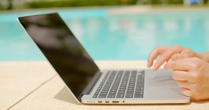 Woman using laptop computer outdoors stock video footage