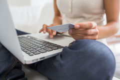 Woman using laptop and credit card.close-up hands Stock Images