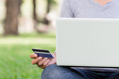 Woman using laptop and credit card shopping online Stock Photos