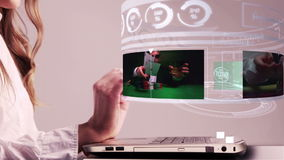 Woman using laptop with gambling holographic interface