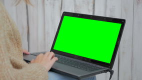 Woman using laptop with green screen. Business, communication, freelance and internet concept stock footage