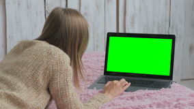 Woman using laptop with green screen. Business, communication, freelance and internet concept stock video footage