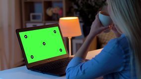 Woman using on laptop with green screen at home stock video footage