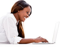 Woman using a laptop Stock Image