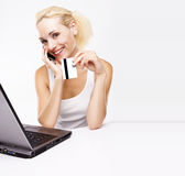 Woman using laptop, holding credit card Stock Images
