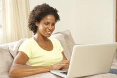Woman Using Laptop At Home Stock Image