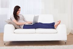 Woman using laptop at home Stock Photography