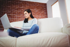 Woman using laptop at home Royalty Free Stock Photo