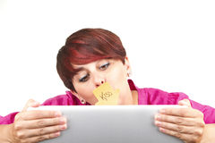 Woman using laptop and kissing the screen Stock Photo