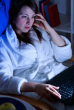 Woman using laptop at night Stock Photos