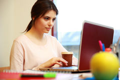 Woman using laptop at office Stock Image