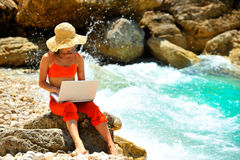Woman using laptop outdoor Royalty Free Stock Image