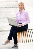 Woman using laptop outdoors Stock Images