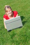 Woman using laptop outdoors. Young woman working on laptop outdoors Royalty Free Stock Images