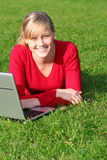 Woman using laptop outdoors. Young woman working on laptop outdoors Royalty Free Stock Photography