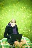 Woman using laptop outdoors Stock Photos