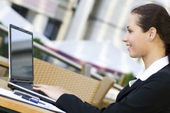 Woman using laptop outdoors Royalty Free Stock Images