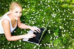 Woman using laptop outdoors Stock Photos