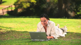 Woman using a laptop outdoors Royalty Free Stock Images