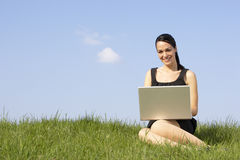 Woman Using Laptop Outdoors In Summer Countryside stock images