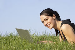 Woman Using Laptop Outdoors In Summer Countryside Royalty Free Stock Photography