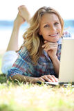 Woman using laptop outside Royalty Free Stock Photo