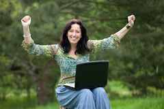 Woman using laptop in park royalty free stock photos