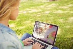 Woman using laptop at park Stock Photos
