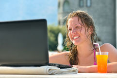 Woman is using laptop in pool Royalty Free Stock Photos