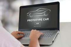 Prototype car concept on a laptop. Woman using a laptop with prototype car concept on the screen Royalty Free Stock Images