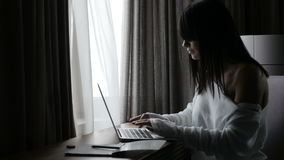 Woman using laptop in room stock footage
