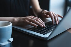 Woman using laptop, searching web, browsing information, having workplace at home or in creative office or cafe. Woman using laptop, searching web, browsing royalty free stock images