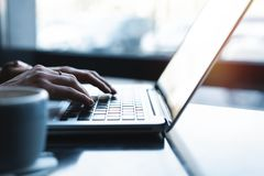 Woman using laptop, searching web, browsing information, having workplace at home or in creative office or cafe. Woman using laptop, searching web, browsing stock image