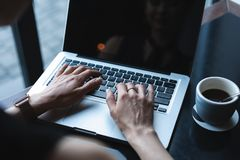 Woman using laptop, searching web, browsing information, having workplace at home or in creative office or cafe. Woman using laptop, searching web, browsing royalty free stock image