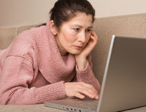 Woman using a laptop Stock Images