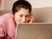 Woman using a laptop Stock Photos
