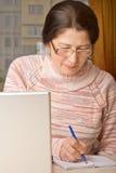 Woman using a laptop Stock Photo