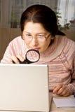 Woman using a laptop Royalty Free Stock Photos